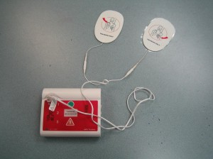 AED trainer with adult pads
